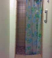 Tiled step up shower in this room